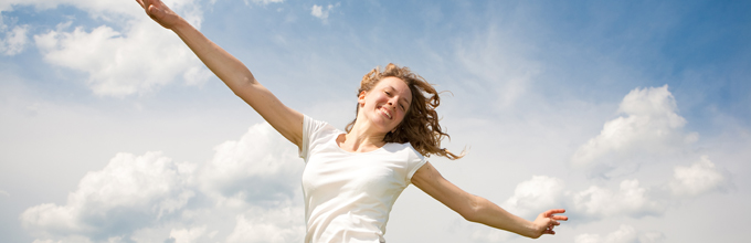 Happy young woman jumping